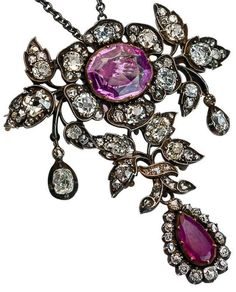 19th Century Pink Sapphire Ruby Diamond Pendant/Brooch. Of floral design, set with pink sapphire, ruby, old cushion- and old rose-cut diamonds, mounted in silver and gold, with French import marks.