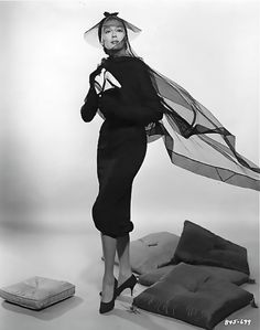 Rosalind Russell in a promotional shot for the film of AUNTIE MAME.  Costume by Orry Kelly