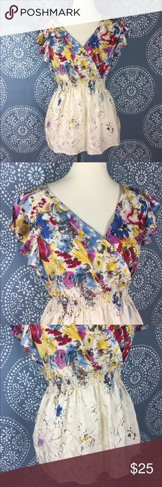 """Anthropologie Edme & Estylle Silk Floral Top Gorgeous silk faux wrap top. It is brightly colored at the top and transitions to a cream colored bottom with spots of floral. Elastic waist under the bust. It is sleeveless with a ruffle to cover the shoulder. Great condition - only flaw is the hanger straps were cut out.  17"""" armpit to armpit and 23"""" long. Anthropologie Tops"""