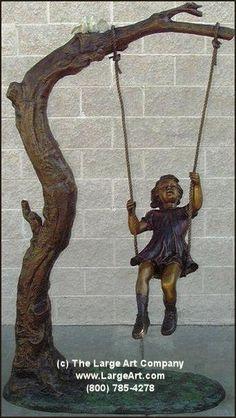 Girl on Swing. bronze garden statue