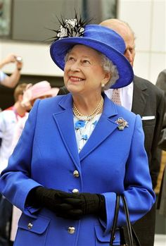 Queen Elizabeth II smiles as she meets one of the taller members of the Great Britain team during a tour of the Athletes Village during the London 2012 Olympics Games on July 28, 2012. in London, England.