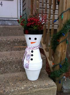 #Snowman #potperson made from #gardenpots with a #festive #christmasribbon