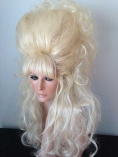 Drag Wig with wave over bangs, sides pulled back with flip over top. Pale Blonde.