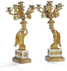 A pair of six-light Charles X gilt bronze and white marble c