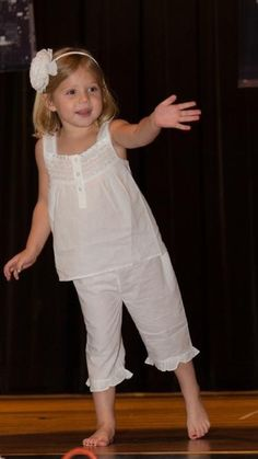 Gorgeous little girl modeling our Lindsey capri pants set. A breezy outfit for hot summer evenings. The fashion show was at The Linen Closet in Delray Beach, FL. Girls Night Dress, Dresses Kids Girl, Kids Outfits, Girl Night, Baby Frocks Designs, Kids Frocks Design, Baby Girl Dress Patterns, Baby Dress, Kids Nightwear