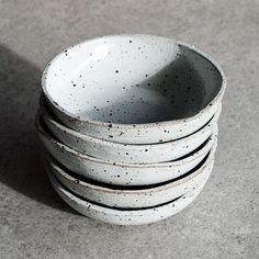 White speckled bowls. #susansimonini #ceramics #pottery #australianceramics #ceramicdesign #tableware #ceramicstudio #ceramicbowl