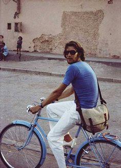 A bike-riding Yves Saint Laurent, from Fondation Pierre Bergé - Yves Saint Laurent libre à Marrakech ...inhabituel !