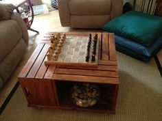 """Inspired by another pin, my """"crate"""" table has a DIY chess board set over the hole and held in place by 3 small dowels."""