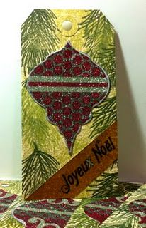 Burnished velvet ornament on tag. Punchinella mask.