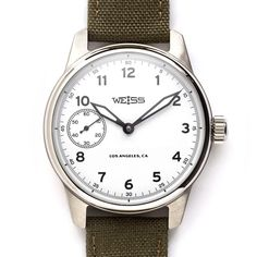 Weiss Standard Issue Field Watch White Dial -- not just b/c of the name. Not a big watch guy but this is gorgeous.