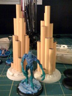 Pencil spires - What a cool idea for scatter terrain. Whilst these have been built as ice wall markers for Malifaux, I'd probably do clusters of two or three on a wooden base.