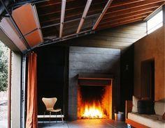 Outdoor fire place for beer garden.    Fernau & Hartman West Marin garage door ; Gardenista