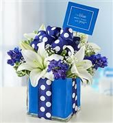 Blue and white flower arrangement with carnations, and poms.