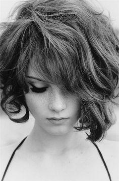 Asymmetrical short curly hair