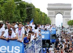 Bienvenue: French Olympic athletes celebrated on board double decker buses that paraded through the streets of Paris, to the delight of flag-waving crowds. Olympics 2012