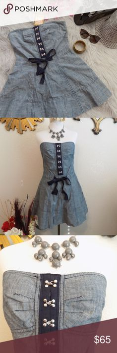 Juicy Couture Chambray Dress New with tag. 100% Cotton. Tube dress with shorts inside. Shorts has buttons for easy access for call of the nature. Size zip closure with hooks. No pockets. Belt ribbon is only for design. Minor flaw, top button hook is loose. Please check last photo. Seamstress can surely fix it. Price reflects the flaw.  Measurements ( Laying Flat):  Bust 16-17, Waist 14.5 , L 23  Please use the measurements as your guide. Measure yourself before purchasing. You know your body…