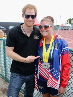 Harry beems with pride as he points at US team member, Ashley Anderson's silver medals won...