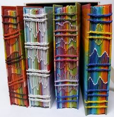 Rainbow Journals (with a page for each day of the year) by Gail Stiffe    Handmade, hand-dyed paper. Four books in a box, one book for each season. Hand bound with innovative stitching.
