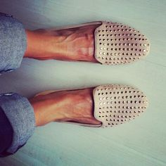 beige studded loafers.