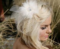 no mannequin plus feathers  http://www.etsy.com/listing/86871082/mariah-ivory-bird-cage-wedding-veil