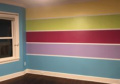Our compromise for a rainbow room - stripes!  Bottom stripe is a bit bigger.  White lines are size of tape.  We sealed them with white before painting stripes.