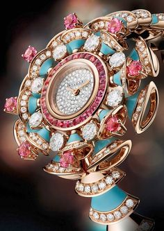 Bulgari Diva high jewellery pink gold watch swirls with brilliant-cut diamonds, pink tourmalines and turquoises and a diamond snow-set dial. Fancy Watches, Trendy Watches, Elegant Watches, Beautiful Watches, Cool Watches, Watches For Men, Bvlgari Gold, Bvlgari Watches, High Jewelry