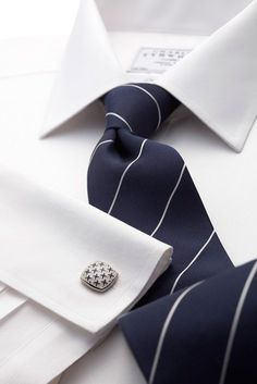 Navy and white fine stripe woven tie.