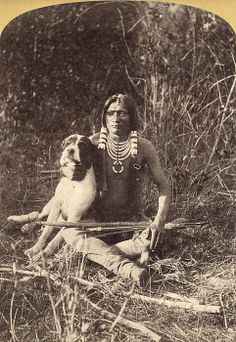 A young Ute man with his dog, in Utah. Photograph by John K. Hillers, c1874.