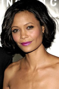 Thandie Newton wearing a sizzling, bright violet lip color