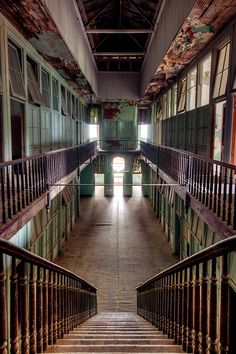 The abandoned great hall inside an old brothel in historic Hot Springs Arkansas. Walter Arnold Photography