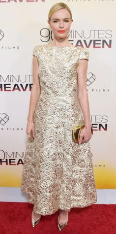 """Kate Bosworth looked positively heavenly for the 90 Minutes in Heaven premiere, sweeping the red carpet in a gilded brocade Schiaparelli Couture midi-length creation and piling on the gold with a metallic minaudiere, drop Look of the Day - September 02, 2015 - """"90 Minutes In Heaven"""" Atlanta Premiere from InStyle.com"""