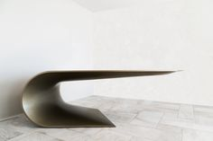 """Bent design: eleftherios ambatzis The inspiration for Bent comes from the idea of bending a sheet of metal to form a new elevated horizontal level. Half a ton in weight, the steel desk appears as though it is about to fall, but is perfectly weighted and very stable due to a complex structure hidden under its """"skin"""". dimensions: 120X260 cm. Bending, Objects, Desk, Steel, Chair, Fall, Inspiration, Furniture, Home Decor"""