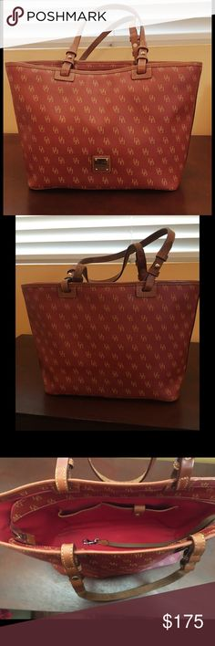 Red Dooney & Burke Canvas Purse Red canvas tote with brown leather handles. Excellent condition.                                                    💰 Priced to SELL FAST  📩 Only competitive OFFERS considered 🚫 No trades, PM only ❓ Questions in the comments 👇  🌻Thanks for the visit and share love ! Happy Poshing! Dooney & Bourke Bags