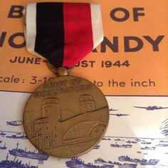 the_ww2_memoirs Pictured above is a US Army of Occupation medal which was awarded from 1946-1990 for 30 days of continuous service in a former enemy land. They had the Bridge at Remagen on the front and Mount Fuji with two ancient Japanese ships in the water on the back with 1945 on the bottom. It was first approved by Dwight D. Eisenhower on June 1st, 1946 and was then awarded not very long after. It was awarded to those who served in Italy from (1946-1947), Austria, (1946-1947), Germany…