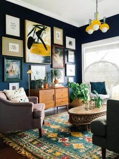 i like the light and the rug, the mix of styles... no peacock chair, I promise :) the dark navy walls are stunning too!