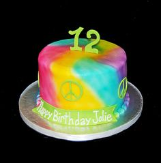 Tie Dye and peace signs airbrushed 12th birthday cake