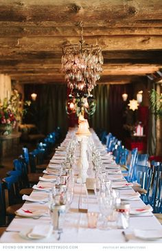 Long wedding table & blue mismatched chairs | Photography: welovepictures, Venue: Halfaampieskraal