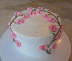 Carrot cake with vanilla bean Swiss meringue buttercream, with hand piped royal icing blossoms.