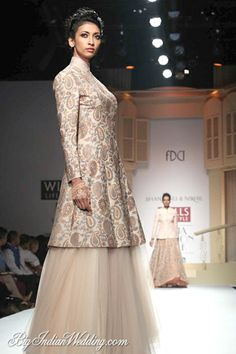 Shantanu Nikhil elegant evening wear collection****This style jacket with skinny cropped silk pants and heels