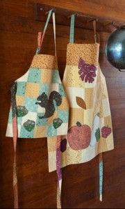 QUILT#104 – Home & Hearth Blessings Aprons, Table Runner, and Hot Pads
