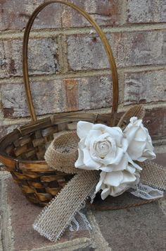 Simple burlap bow with flowers on top and lace at base of embellishment