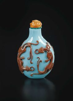 A RED-OVERLAY TURQUOISE GLASS SNUFF-BOTTLE, QING DYNASTY, 19TH CENTURY