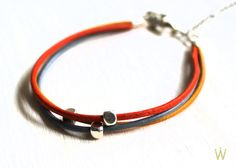 http://de.dawanda.com/product/39940390-gluecksbringer-Lederarmband-orange-gelb-gr