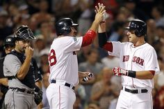 Boston Red Sox's Will Middlebrooks, right, celebrates his two-run home run that also drove in Adrian Gonzalez, center, as Detroit Tigers' Alex Avila, left, watches in the eighth inning of a baseball game in Boston, Monday, July 30, 2012. (AP Photo/Michael Dwyer)