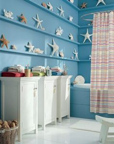 I can't get enough of these seashells on the ledges of this bathroom!  I think I'd arrange and rearrange them every five minutes!