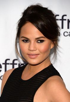 Chrissy Teigen Bobby Pinned Updo - Chrissy Teigen pulled back her chocolate locks into this pinned updo for a fresh and natural look at the Jeffrey Fashion Cares Celebration.