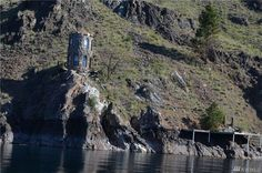 """This two-storey, one-bedroom castle is now up for grabs for just $US89,000 ($116,000). Located in Washington State, US along Lake Chelan, the turret is accessible only by boat and comes with its own large dock. So, technically, you can tell all your friends that it's a """"waterfront property"""". And yes, it appears rather small – 87 square metres to be exact."""
