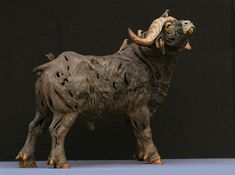 African buffalo with Oxpecker _ stoneware sculpture by ALAN WARING