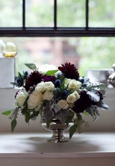 A how-to guide to making this gorgeous fall floral arrangement - with dark patches of black dahlia and clustered, purple carnations, from @Design*Sponge