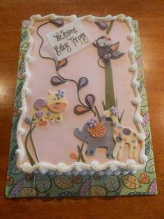 Girls baby shower cake. Baby animals in a baby forest. All in pastels